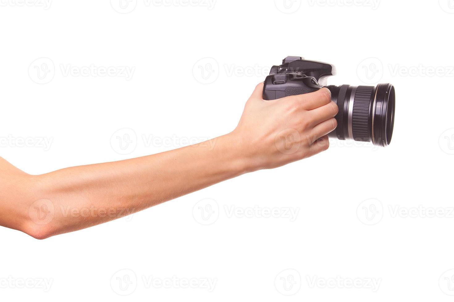 Frauenhände halten die Kamera. foto