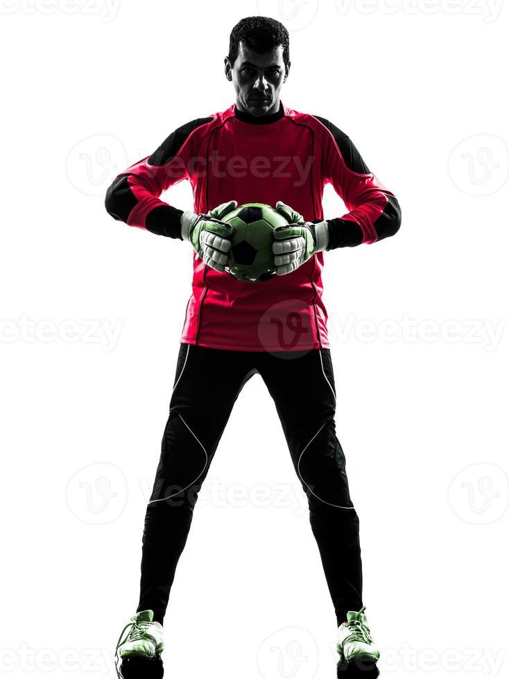 kaukasischer Fußballspieler-Torhütermann, der Ballschattenbild hält foto