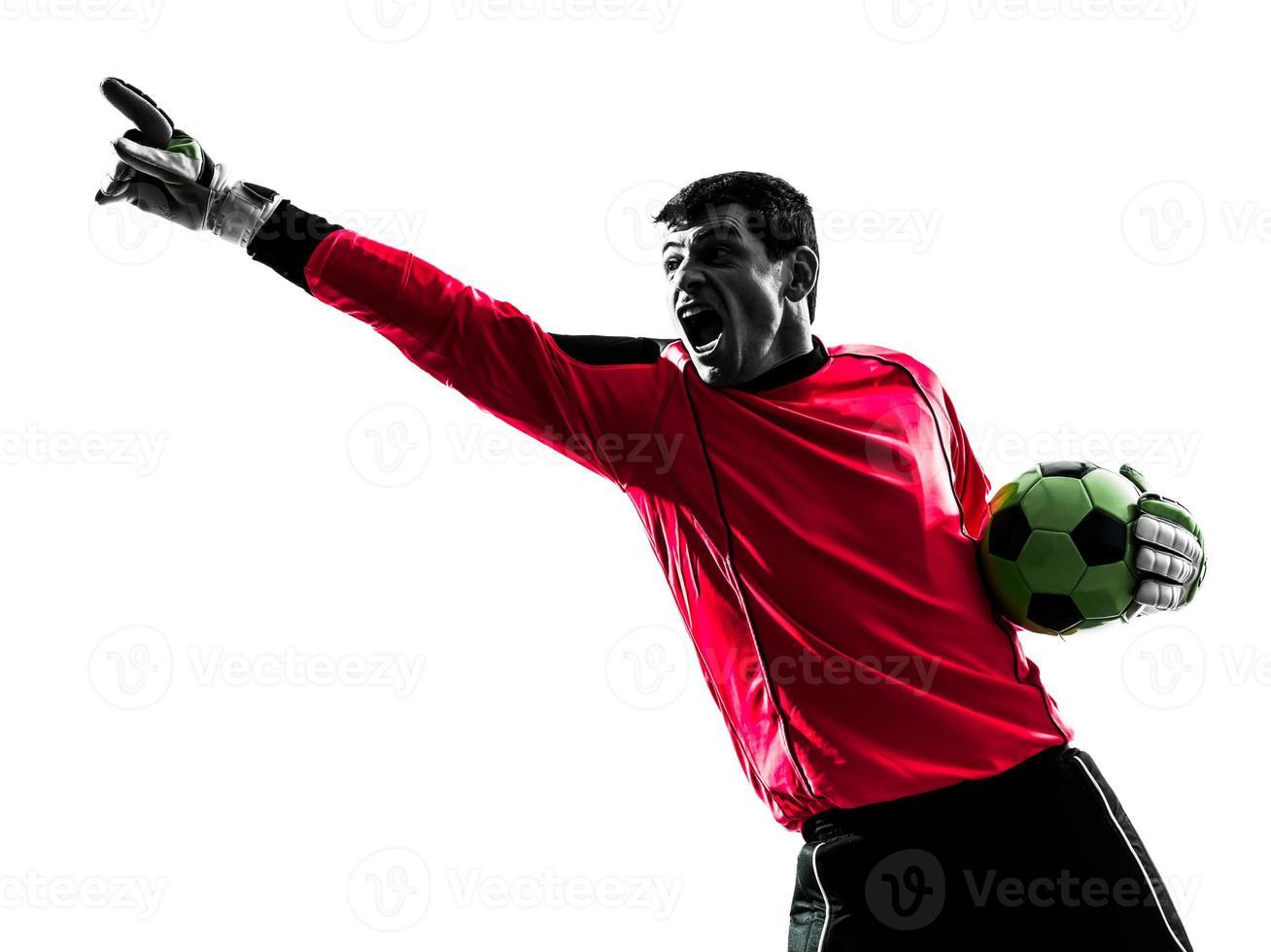 kaukasischer Fußballspieler-Torhütermann, der Silhouette zeigt foto