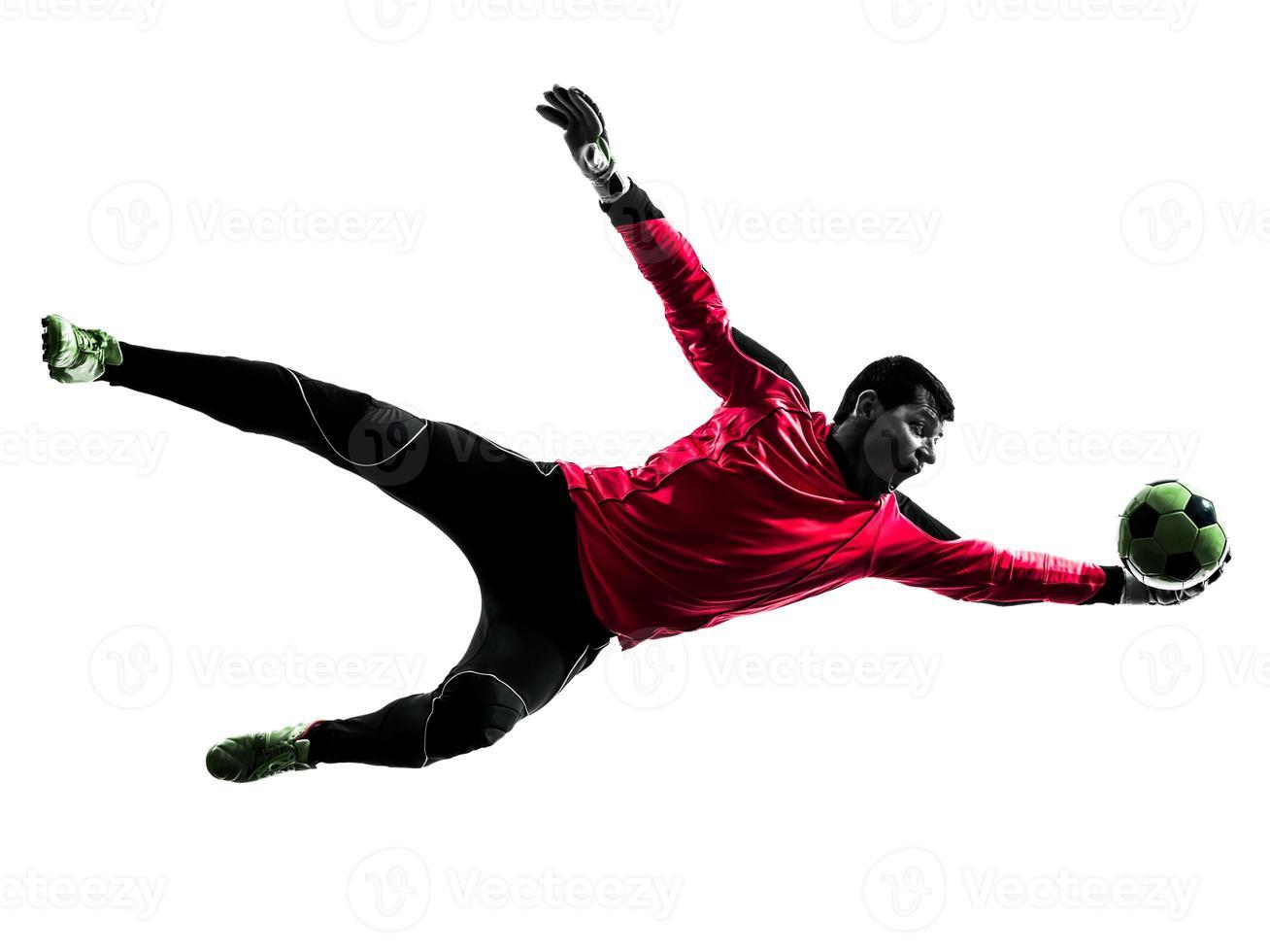kaukasischer Fußballspieler-Torhütermann, der Ballschattenbild fängt foto
