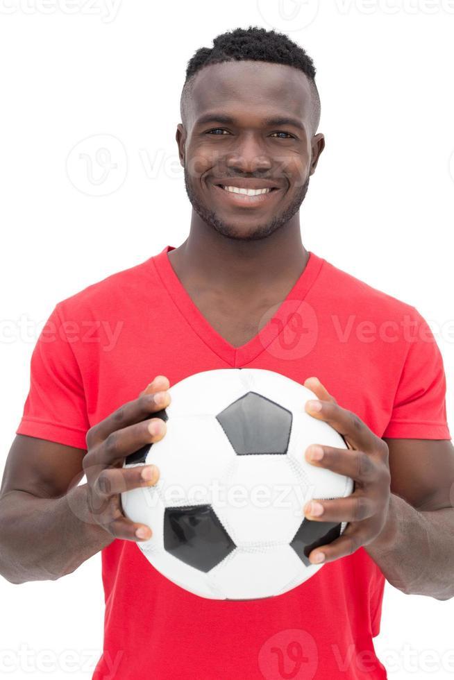 Porträt eines lächelnden hübschen Fußballfans foto