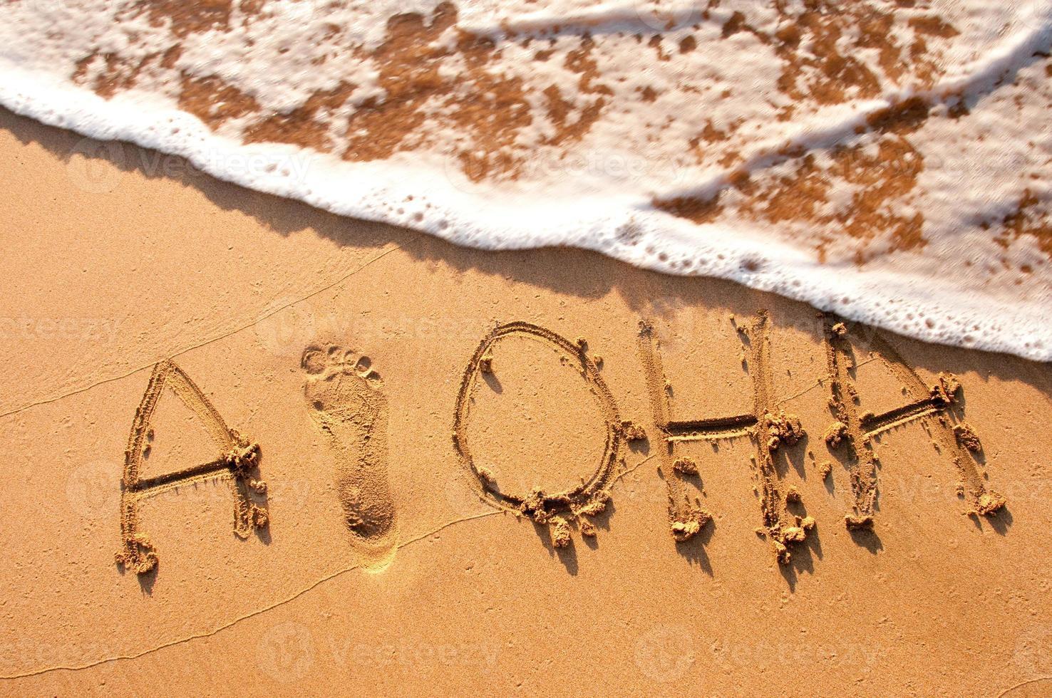Aloha in den Sand geschrieben foto