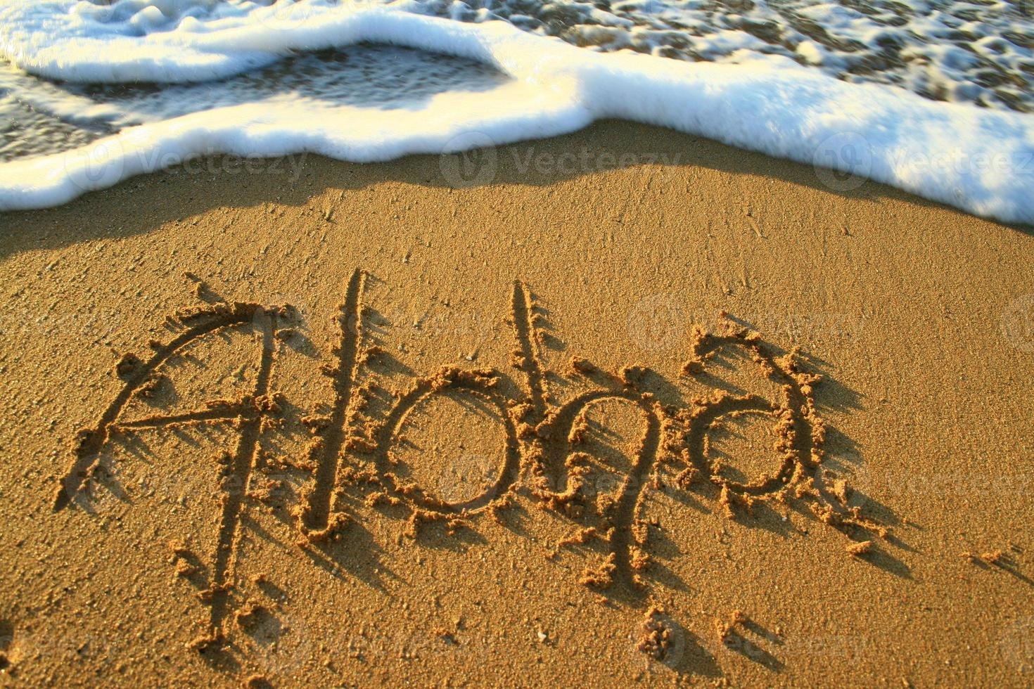 Aloha im Sand foto