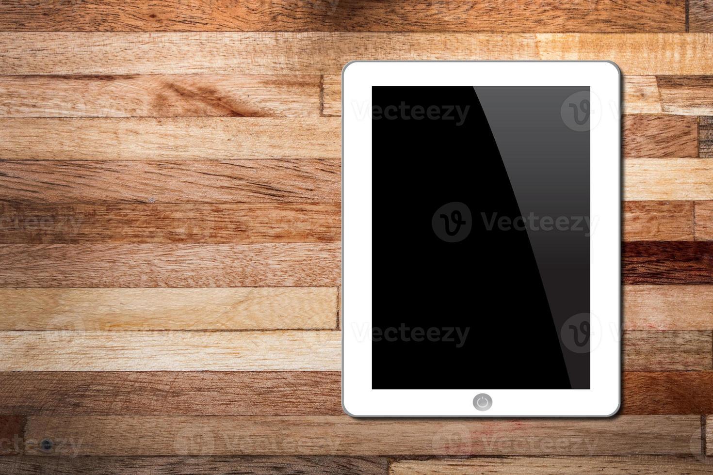 Tablette PC auf hölzernem Hintergrund foto