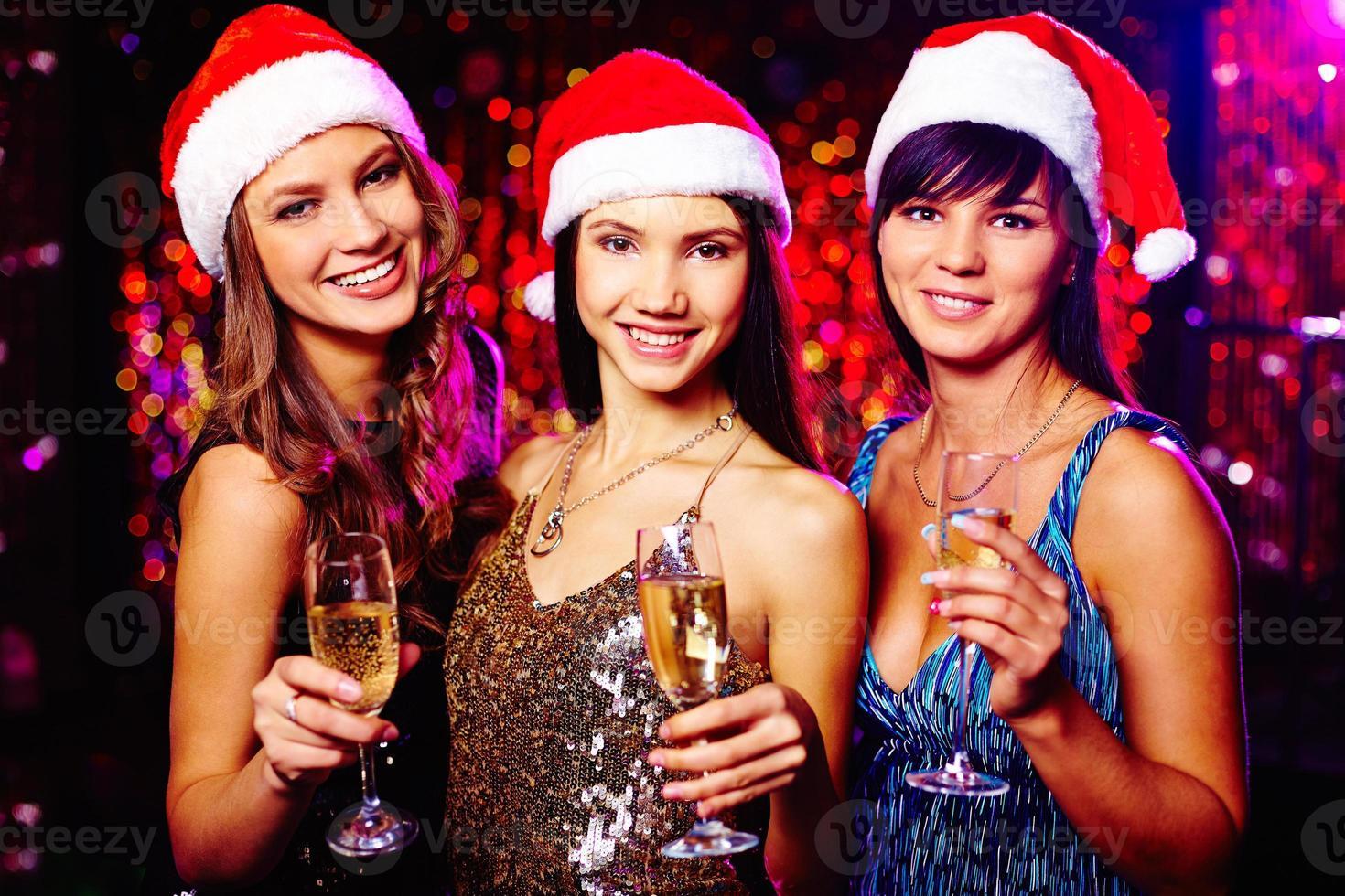 lächelnde Weihnachtsmänner foto
