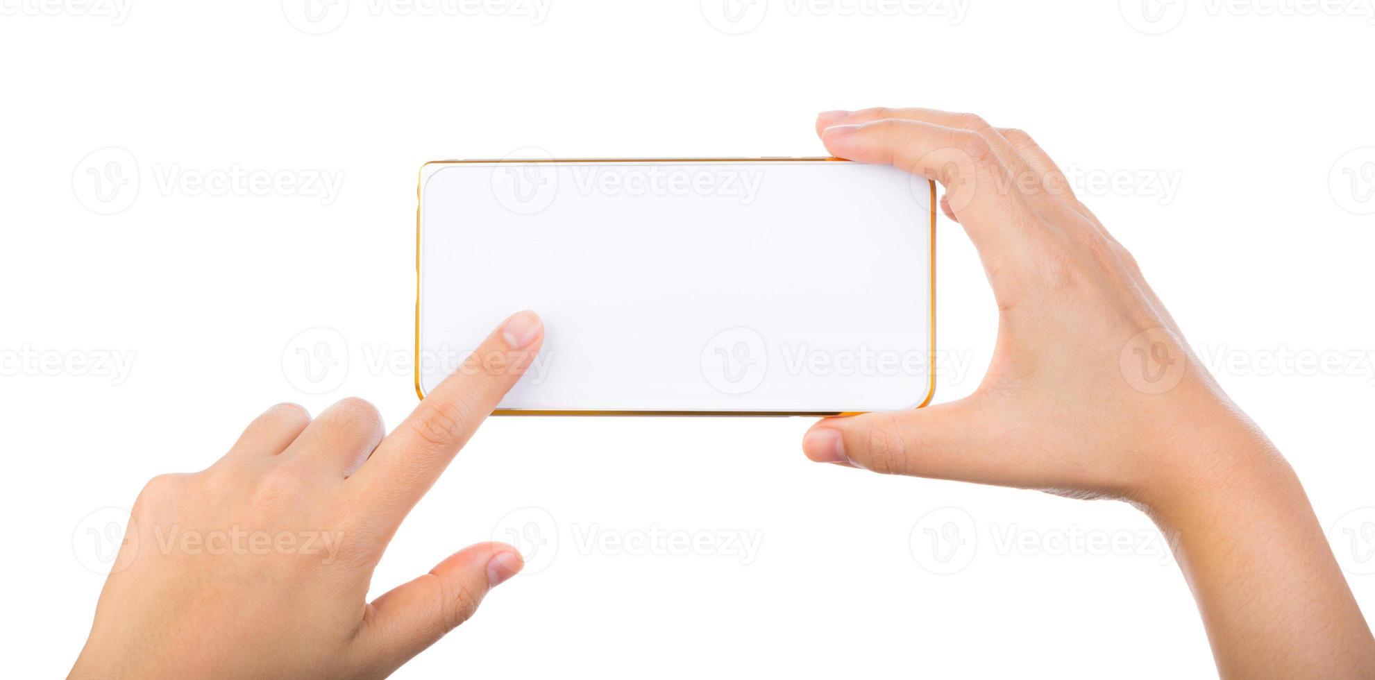 weibliche Hand, die goldenes Handy-Smartphone hält foto