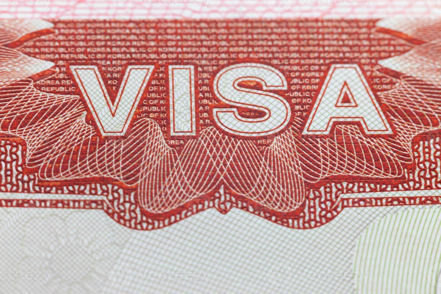 ausländisches Visum auf einer Passseite - genießen Sie den Reisehintergrund foto