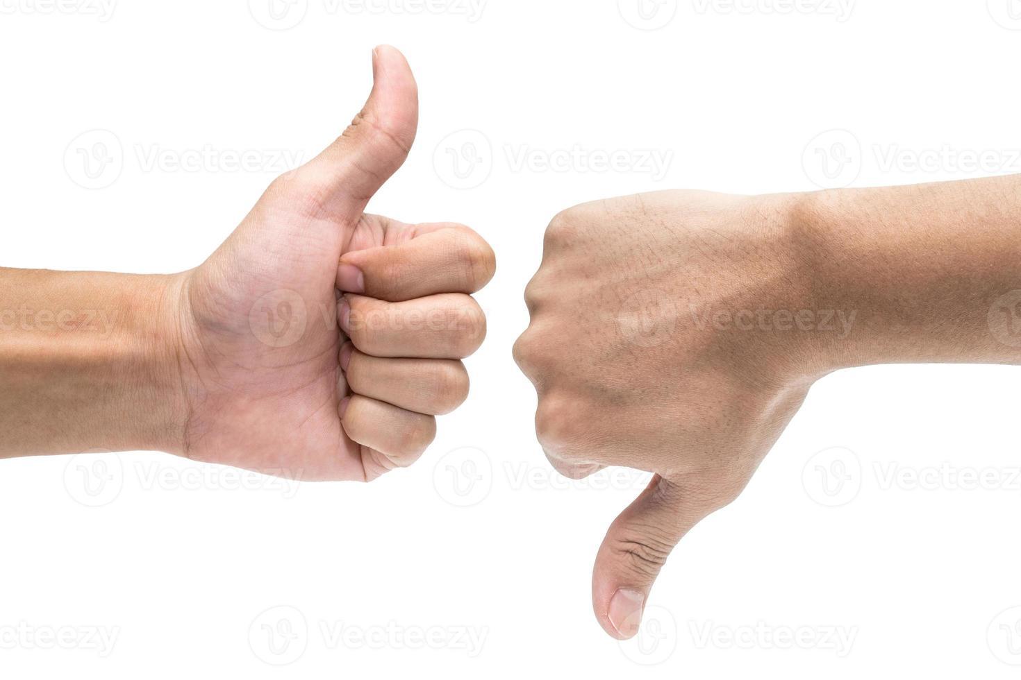 Daumen hoch und Daumen runter Handzeichen foto