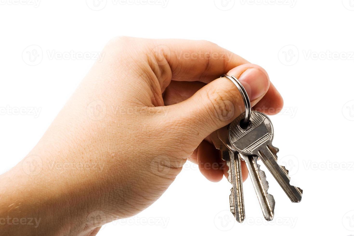Schlüssel in der Hand foto