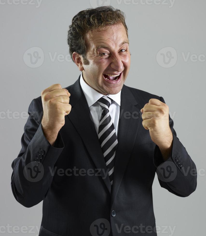 Geschäftsmann jubelt foto