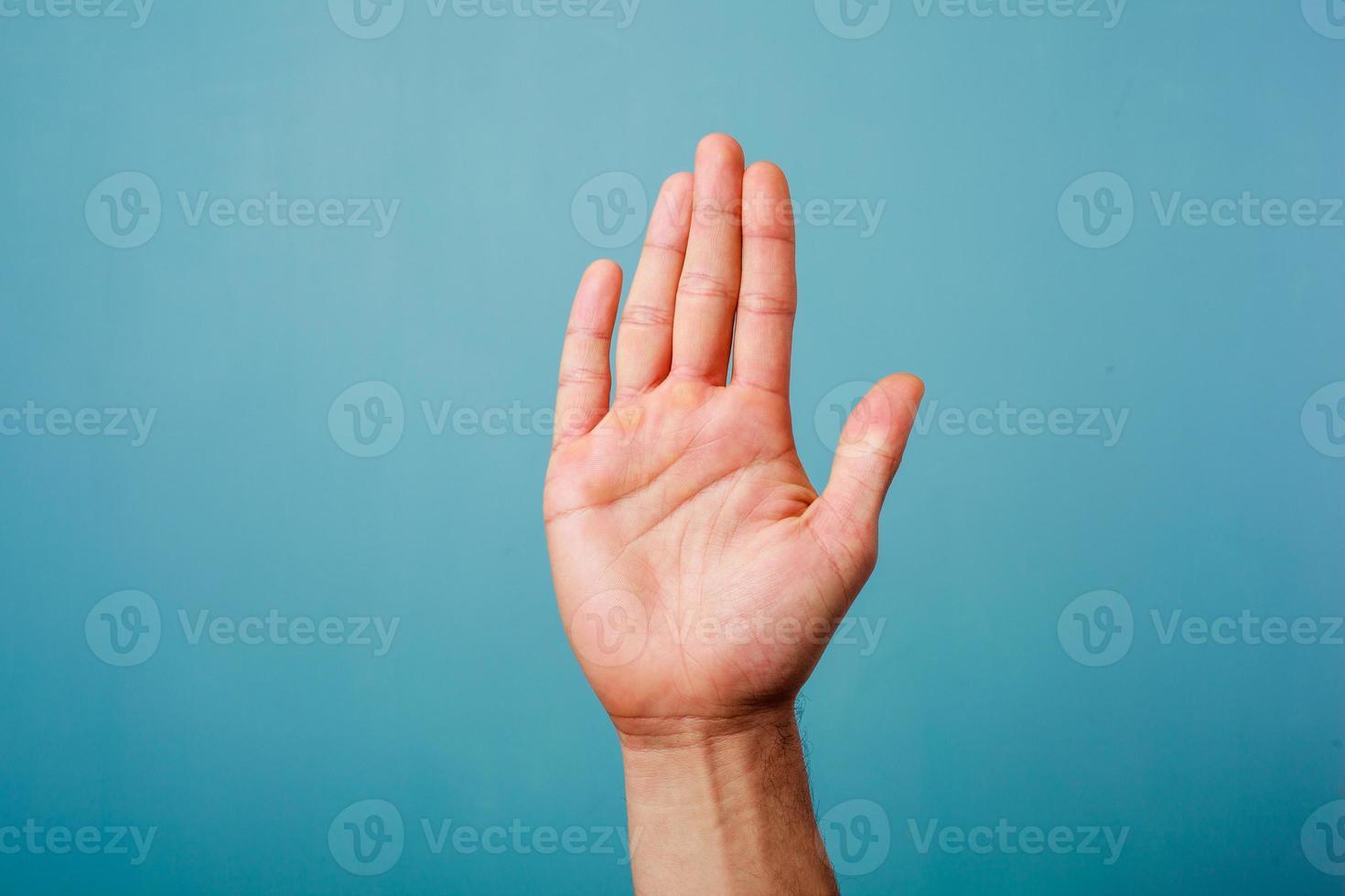 Hand erhoben foto