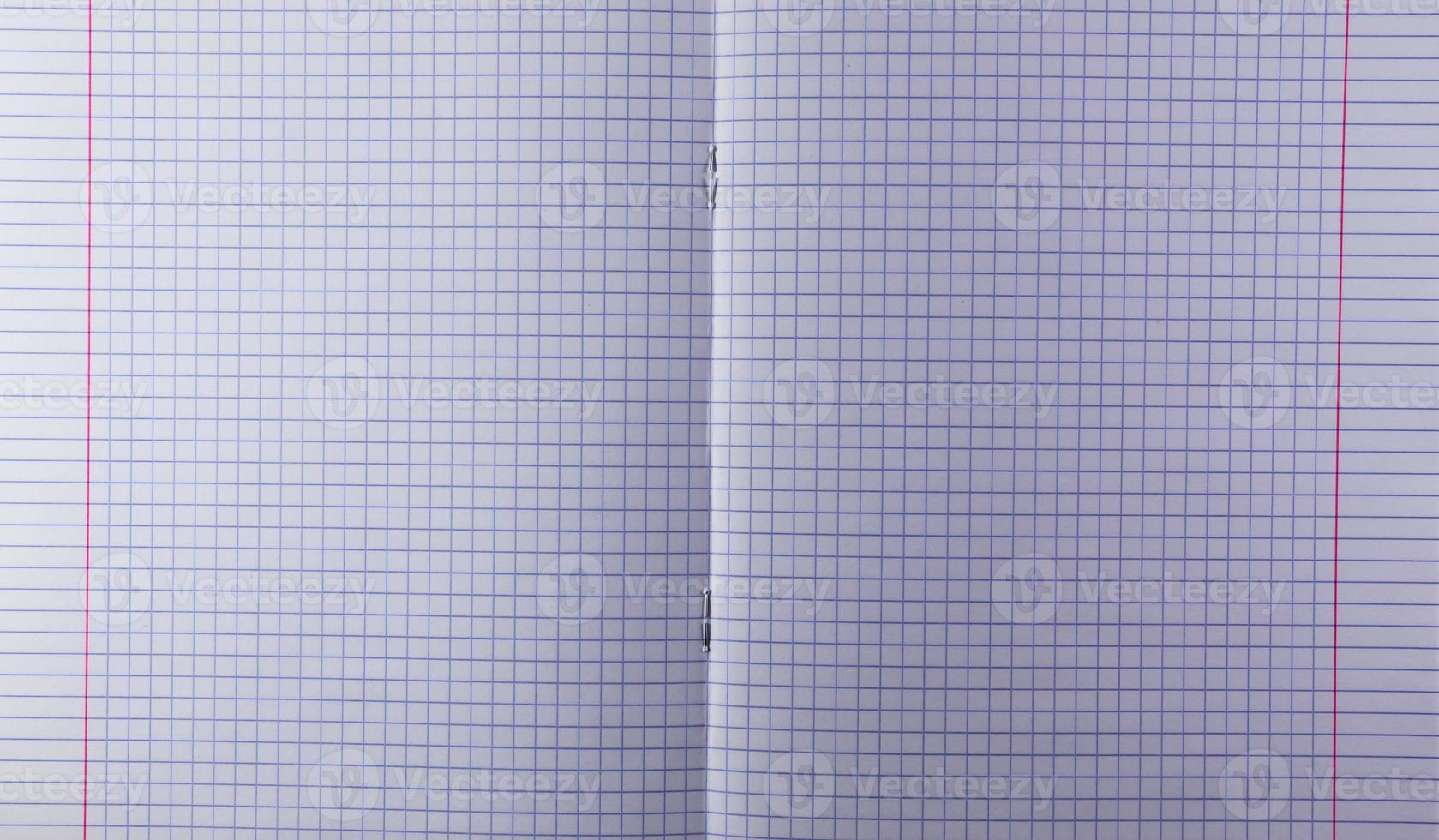 offenes gewürfeltes Lehrbuch foto