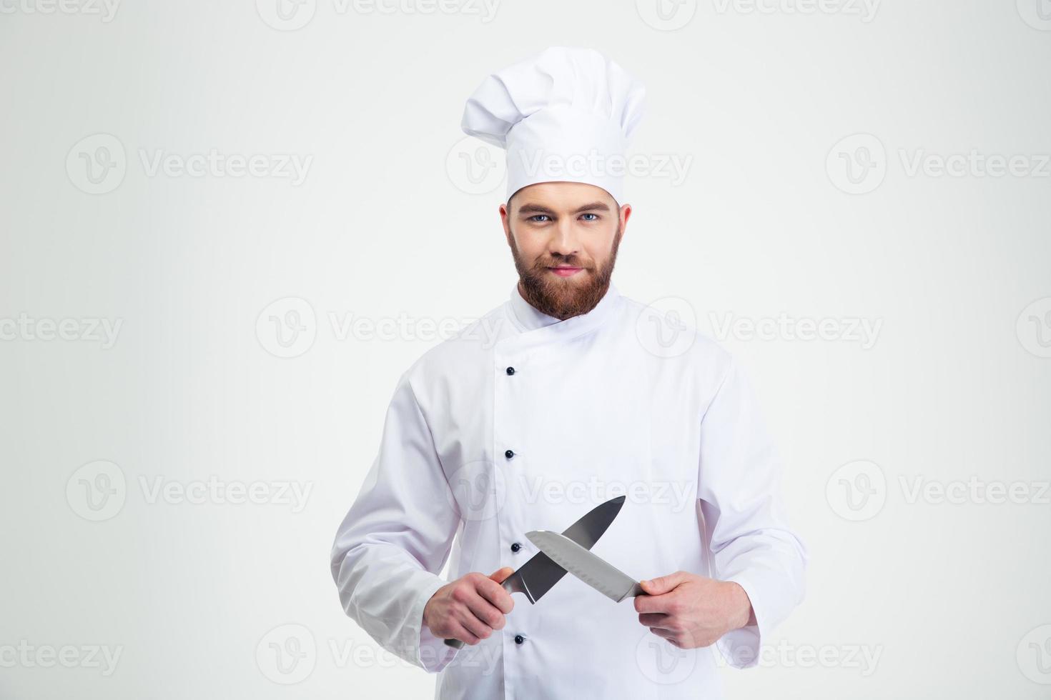 glücklicher männlicher Koch kochen Schärfmesser foto