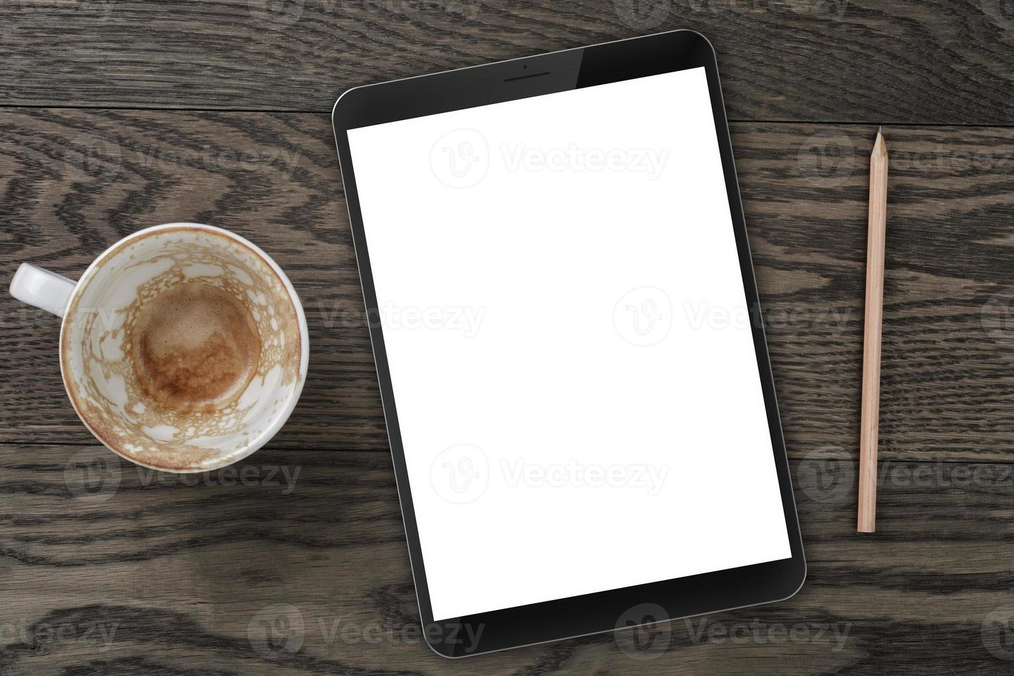 Draufsicht des Tisches mit leerer Kaffeetasse, Tablette foto