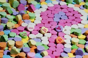 Süßigkeiten in Form eines rosa Brustkrebsbandes foto