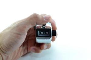 Hand mit Zählzähler foto
