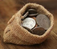 alte Münzen im Sackbeutel foto