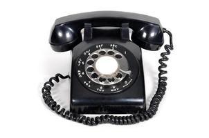 isoliertes Weinlese-Telefon auf weißem Hintergrund foto