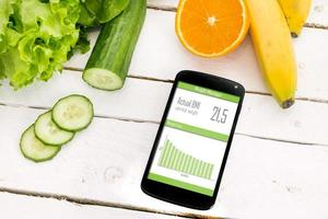 Kontrolle Ihres Gewichtsverlusts mit mobiler Anwendung. foto