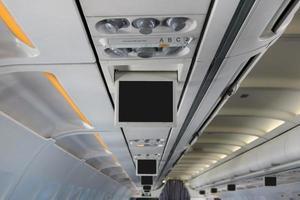 Monitor über Kopf im Flugzeug foto