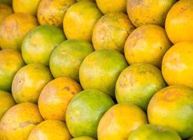 Nahaufnahmefoto des frischen Mandarinenhintergrundes foto