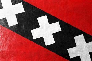 Amsterdamer Stadtflagge gemalt auf Lederstruktur foto