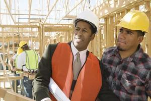 Architekt und Bauarbeiter foto
