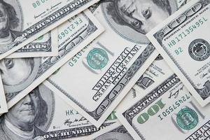 einhundert Dollar Noten Hintergrund foto