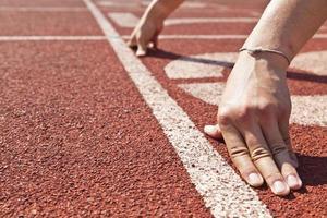 Sprintstart in Leichtathletik foto