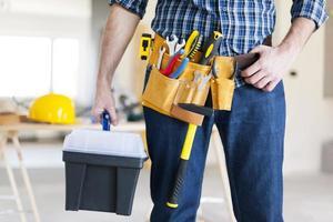 Teil des männlichen Bauarbeiters foto