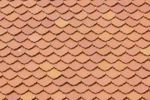 Fischschuppen-Dachziegel im thailändischen Stil foto