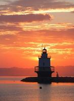 Sonnenaufgang am Spring Point Leuchtturm foto