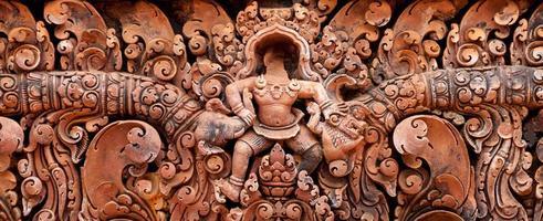 Detail von Steinmetzarbeiten bei Banteay Srei foto