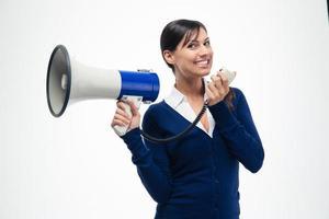 fröhliche Geschäftsfrau, die Megaphon hält foto