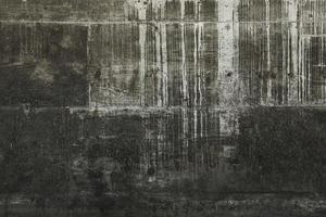 weiße tropfende Farbe auf grauer Wand foto