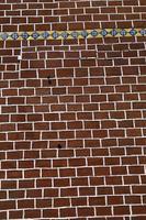 Backsteinmauer - dekorierte rote Backsteinmauer, strukturierte Wand foto