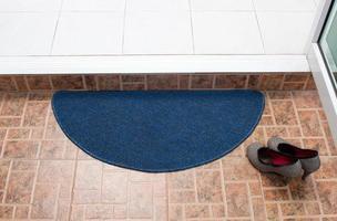 blaue Stoff Fußmatte foto