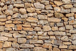 rustikale Steinmauer Textur. foto