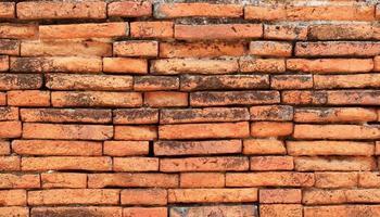 alte rote Backsteinmauer Textur Hintergrund foto