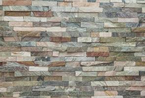 gefälschte Steinmauer Ziegel Hintergrund Tapete foto