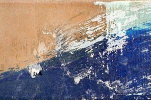 heisere, zerkratzte und geschälte Oberfläche mit blauem und gelblichem Bro