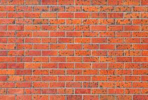 Hintergrund und Beschaffenheit der roten Backsteinmauer des Betons foto
