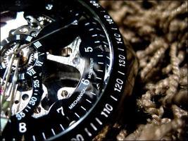 Armbanduhr über Textilhintergrund foto