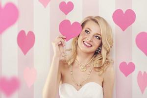 exklusive Frau mit rosa Herzen foto