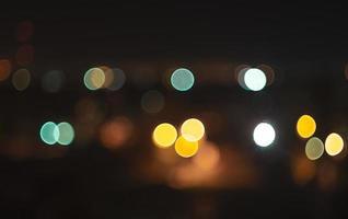 defokussierte Lichter in der Nacht foto