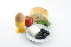 Frühstückseier mit Käse Olivenhintergrund foto