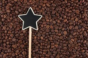 Zeiger, das Zeichen liegt auf Kaffeebohnen