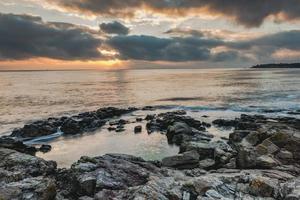 Morgendämmerung am Meer.
