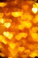 goldener Herzformfeiertagshintergrund foto