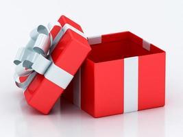 offene rote Geschenkboxen mit weißem Band foto